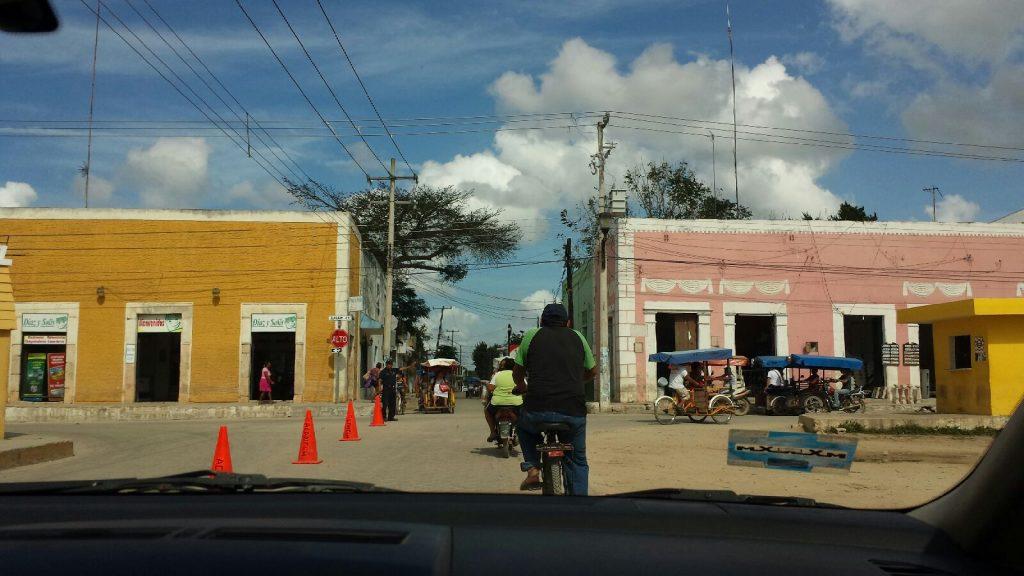 Driving a rental car through Yucatan village