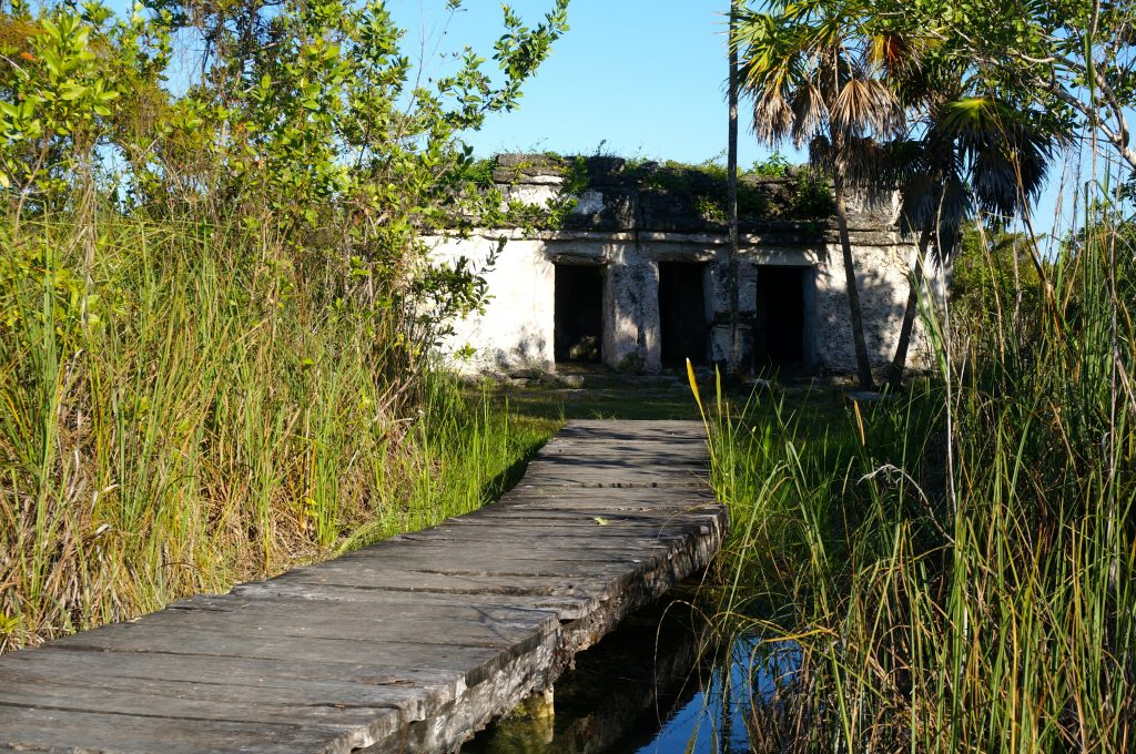 Dock leading to Mayan ruin in Sian Ka'an Biosphere Reserve, visited during tour