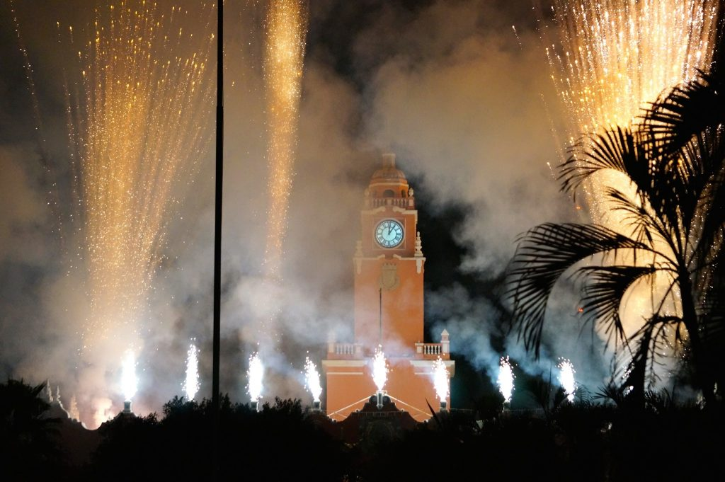 Fireworks go off over the Municipal Palace and clock tower in Merida on the opening night of Merida Fest