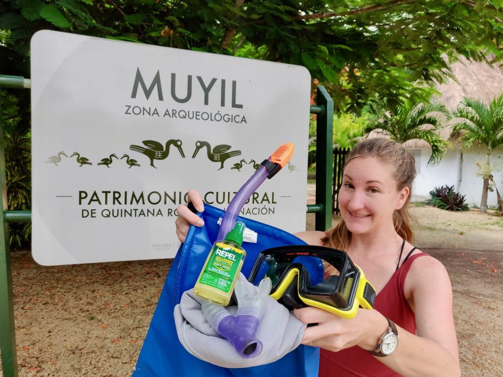 Heather with a bag of what to pack for Muyil and Sian Ka'an Biosphere Reserve Tour: mask & snorkeling gear, natural insect repellent, biodegradable sunscreen and more