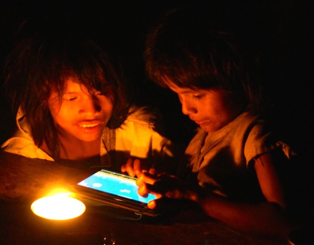 Wiwa children playing Angry Bird