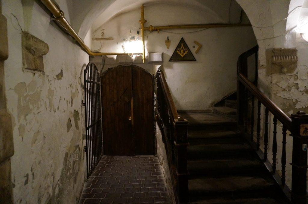 wooden door Lviv masonic restaurant