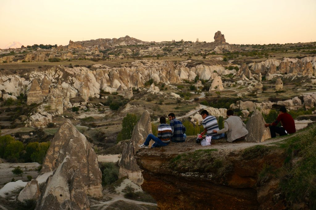 Turkish men enjoying the view at Sunset Point is a relaxing and budget-friendly Cappadocia experience for tourists and locals alike