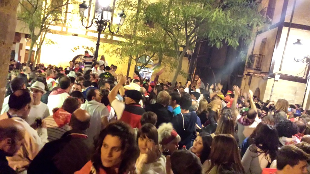 crowd of people at wine fight street party in Haro Spain