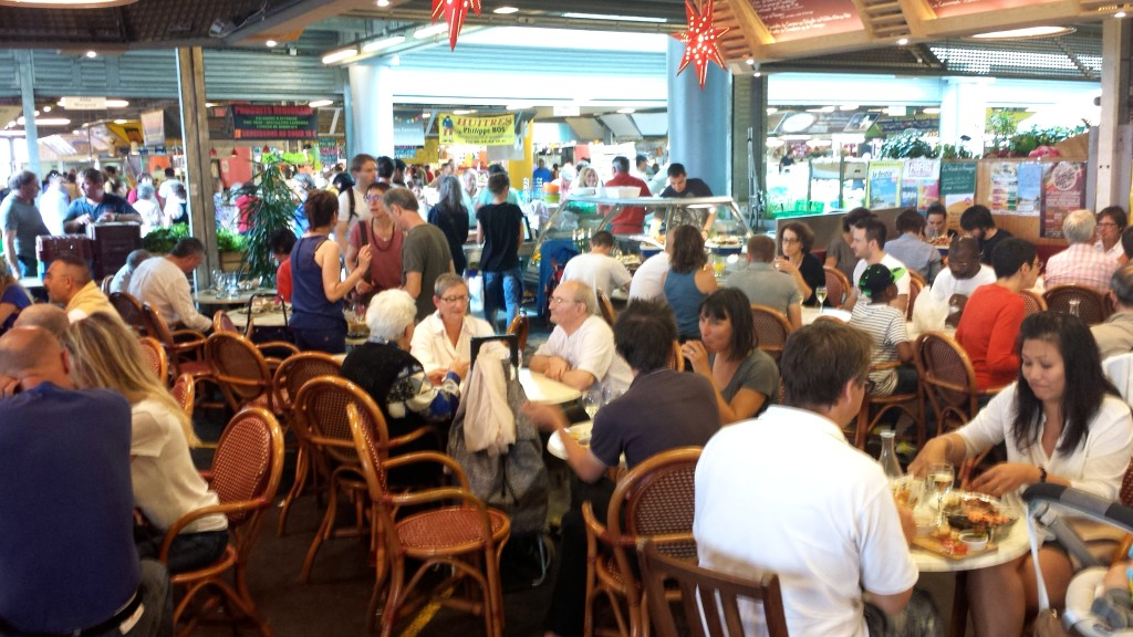 people dining at Marché des Capucins market in Bordeaux