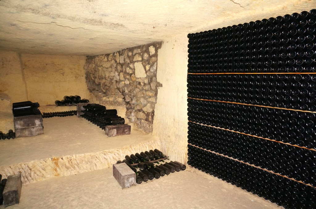 wine cellar in Saint Emilion filled with bottles of wine