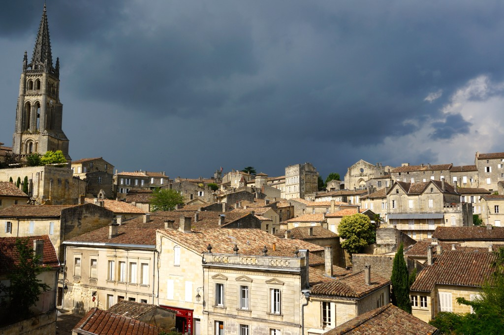 the town of Saint Emilion with storm clouds approaching