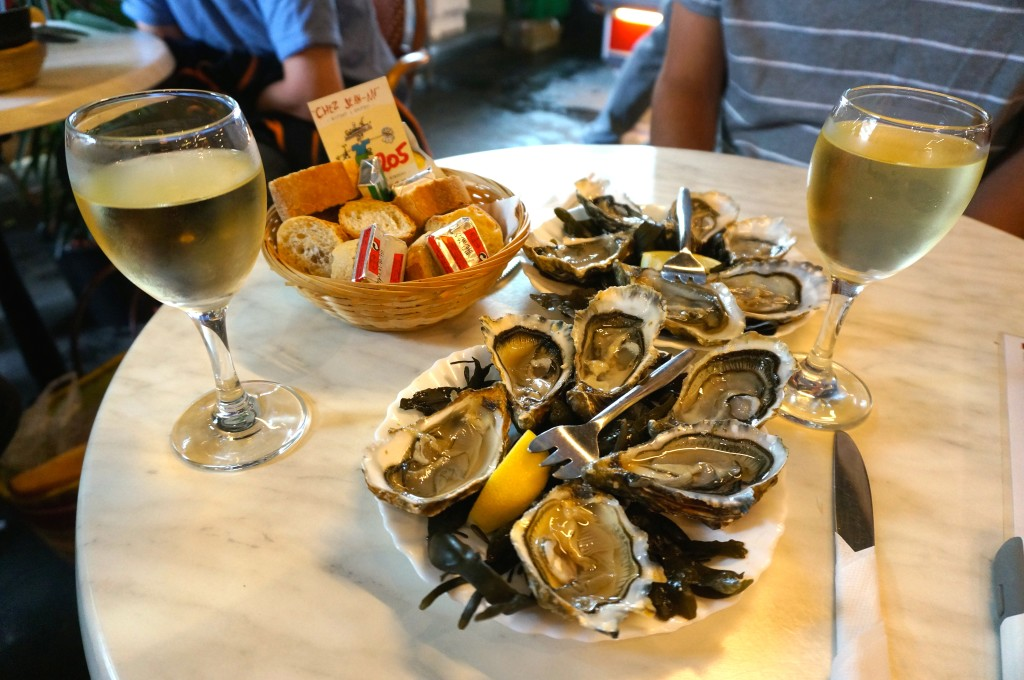 Oysters, wine, and bread at Marché des Capucins