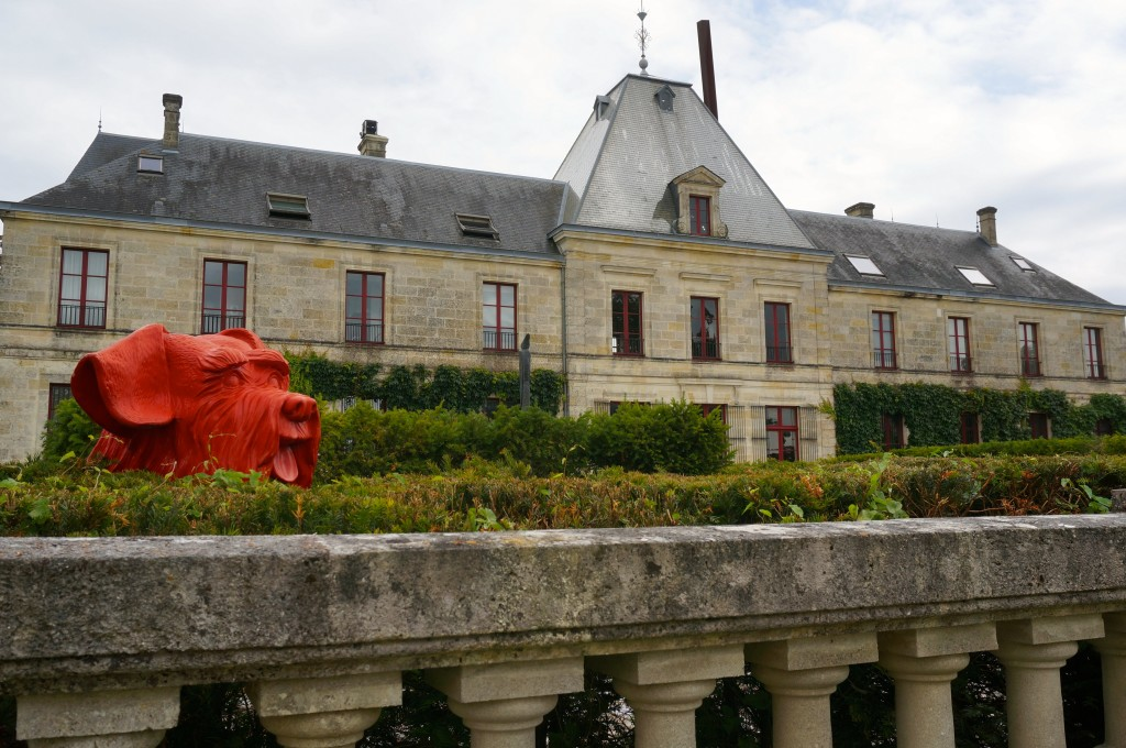 Chateau D'Arsac with big red dog