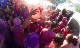 During Spain's Haro Wine Battle, a man dumps red wine all over the crowd during this annual festival