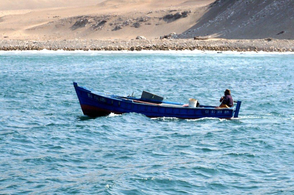 fishing boat in front of san lorenzo island peru
