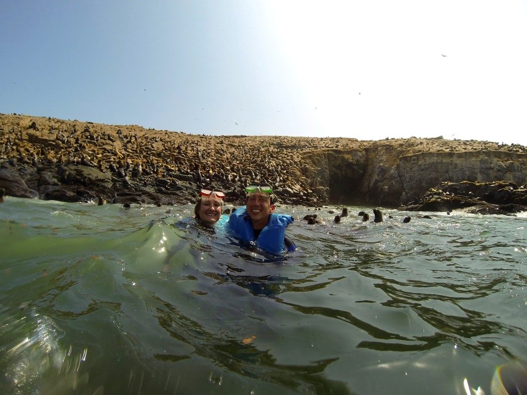 two people (John & Heather) swimming with sea lions Palomino Island Peru