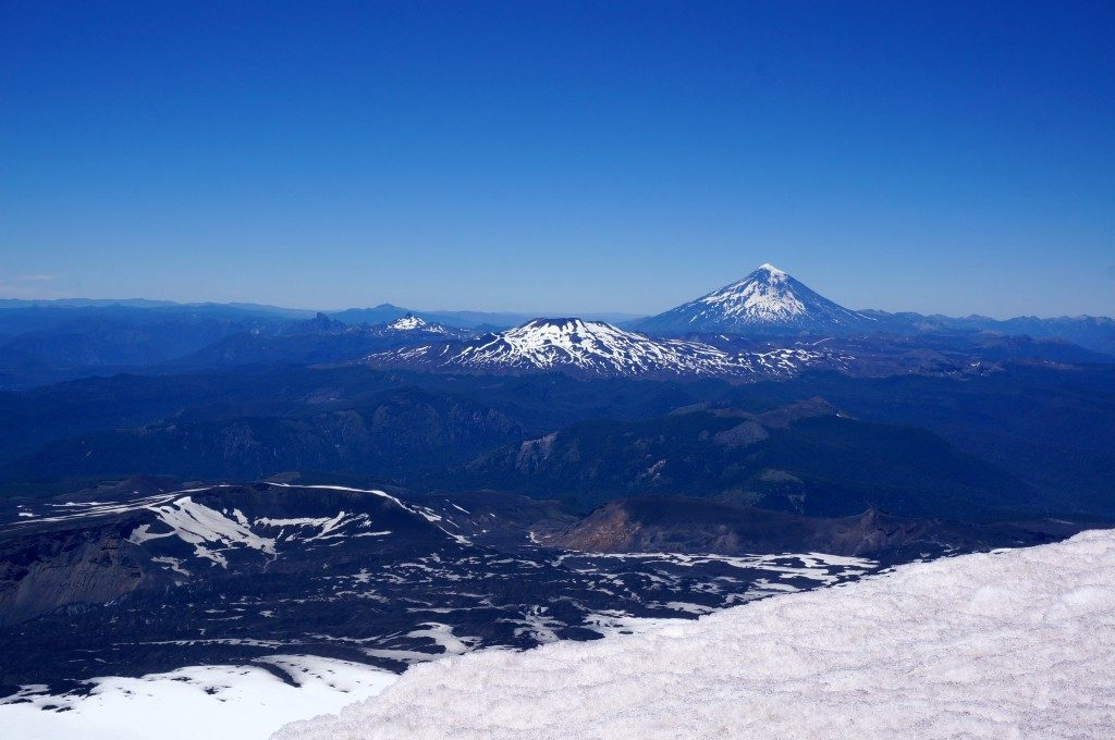 view from atop Volcan Villarrica showing other volcanos and lakes around Pucon