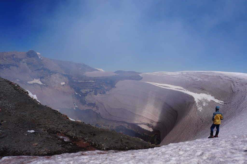 Guy standing inside the rim of Volcan Villarrica