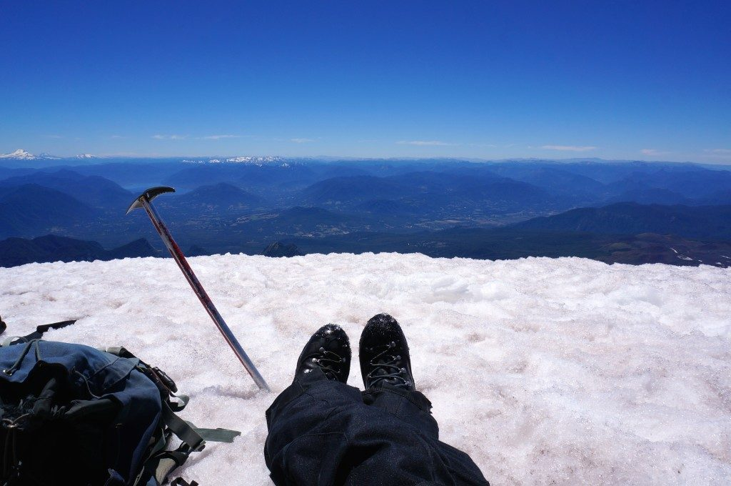 resting at the top of Volcan Villarrica with crampons and ice axe in view