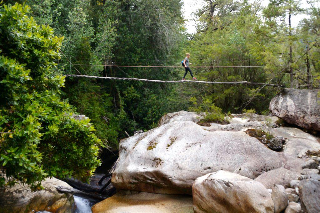Swing bridge river crossing on the way to Arco Iris trailhead
