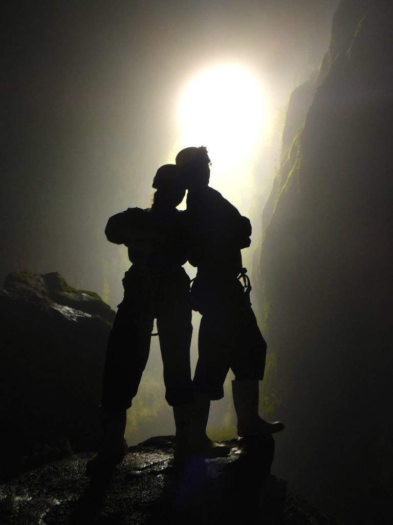 Silhouette of John & Heather posing at the bottom of the Lost World cave