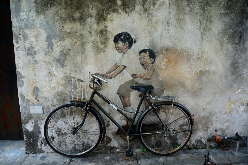 Kids on bike street art