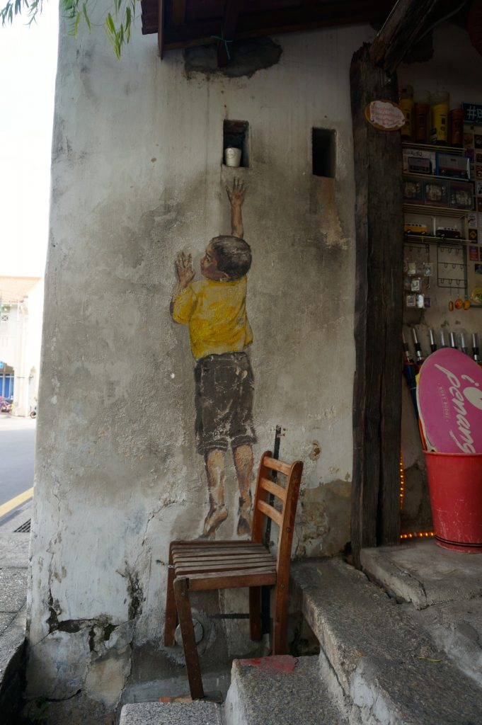 """Boy on Chair"" street art mural"
