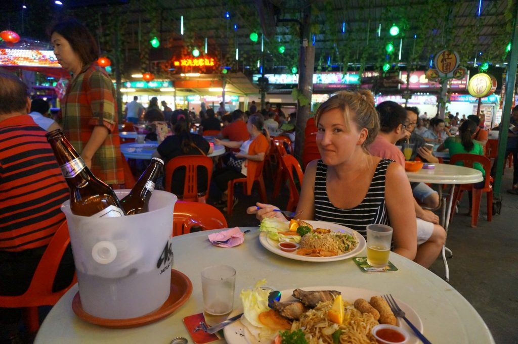 Heather is eating at Red Garden night market and street stalls