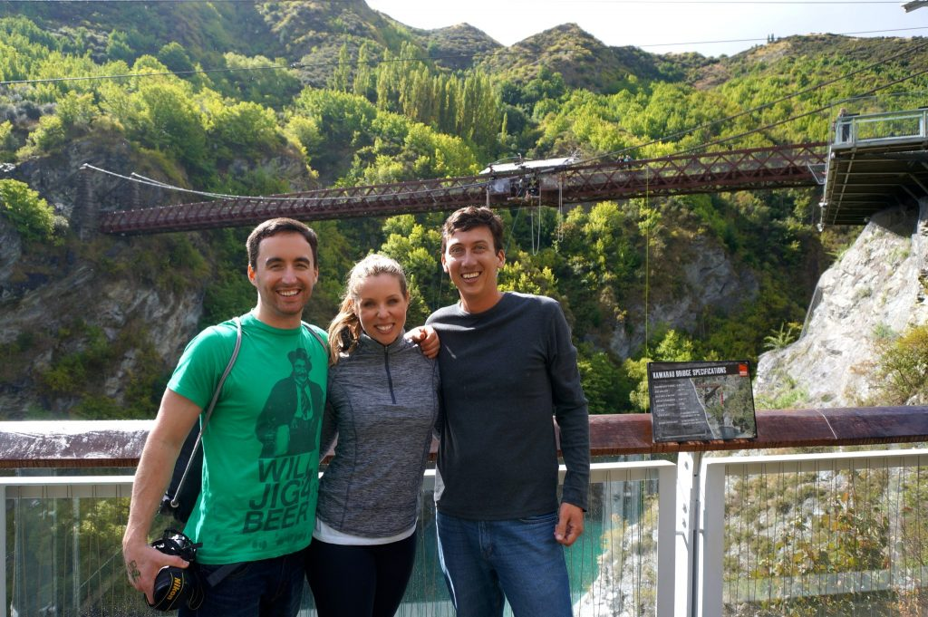 3 friends about to bungy jump off the famous AJ Hackett Kawarau Suspension Bridge