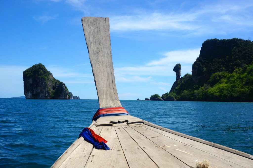 The Four islands tour is one of the top things to do in Railay - here's a longtail boat with view of Chicken Island