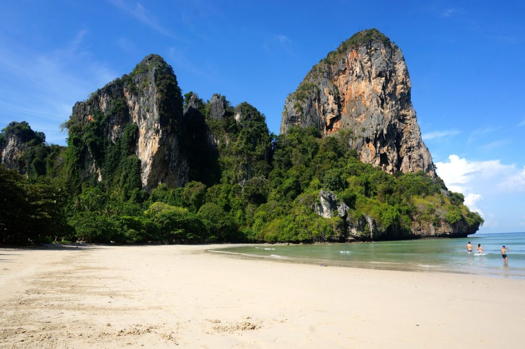 Railay Beach West is surrounded by limestone cliffs