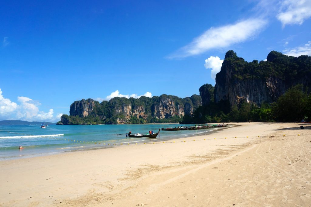 Railay Beach Krabi is surrounded by limestone cliffs and simply relaxing on this beach makes for a great among the best Railay activities
