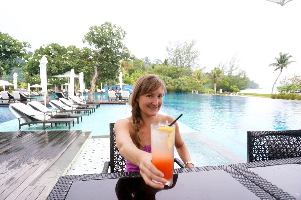 Heather drinks a long and tall poolside cocktail at the Danna Langkawi luxury resort