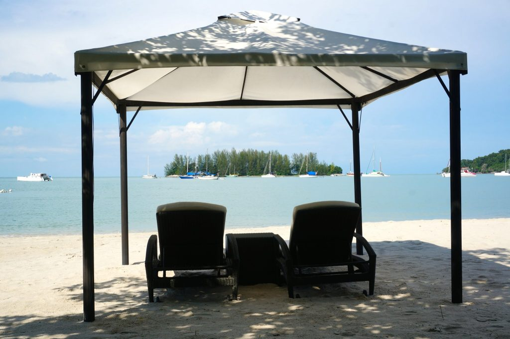 Beach lounge chairs with canopy tent at the Danna Langkawi luxury resort