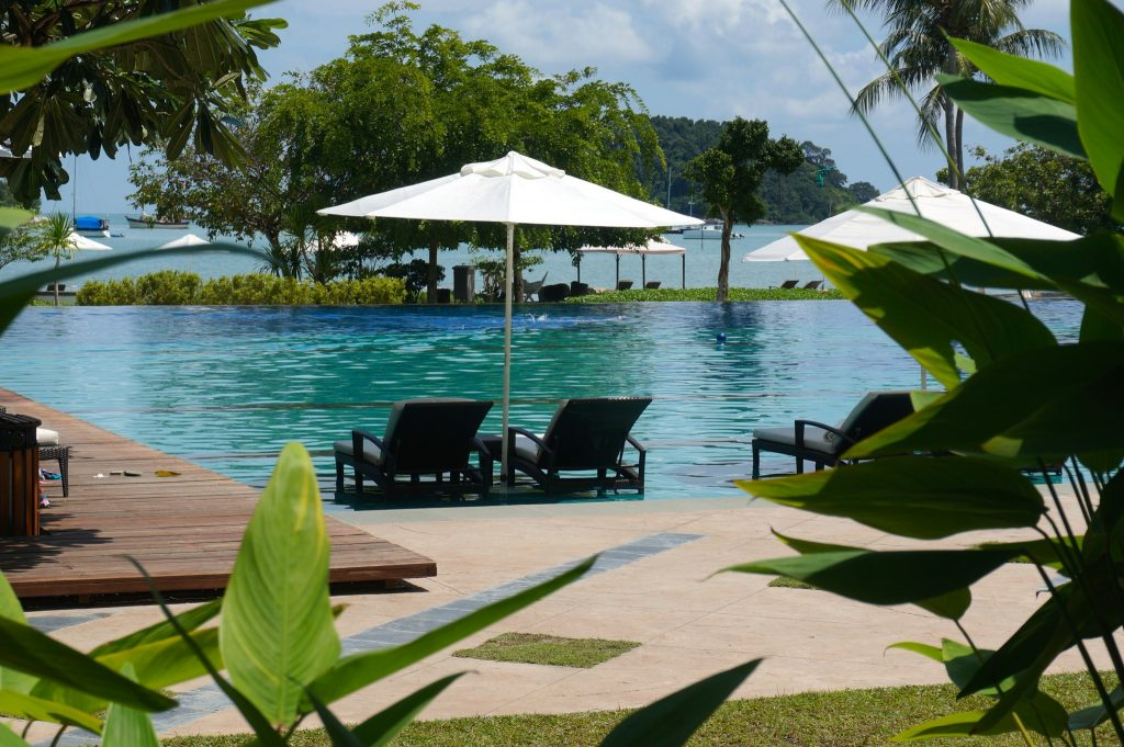Lounge chair with umbrella at Danna Langkawi Malaysia infinity people