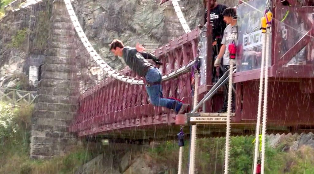 Man about to jump of the AJ Hackett Kawarau Bridge in the rain
