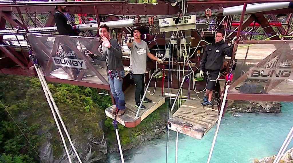 John showing fear while after safety checks waving to friends from the Kawarau Brigdge bungy jump