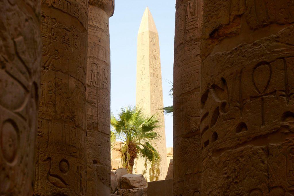 Karnak temple obelisk between columns with hieroglyphics