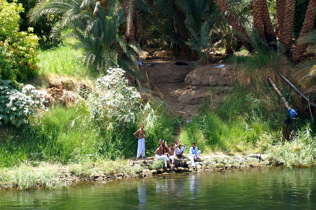People along the bank of the Nile River