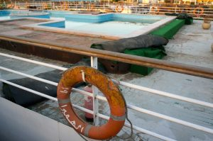 A worn life saver hangs on the rails of a Nile River cruise ship that has fallen to disrepair