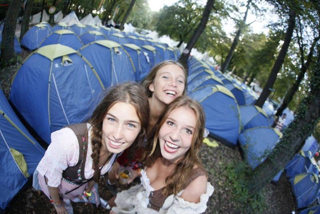 Girls in from of tents at Stoke Oktoberfest camp grounds
