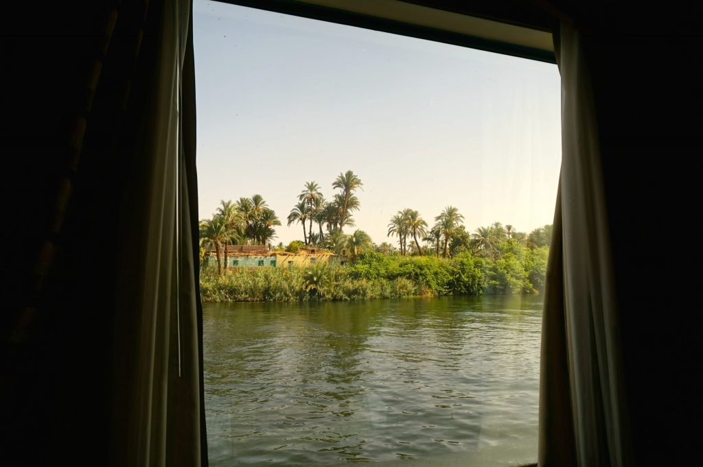 Nile view from window of river cruise ship cabin
