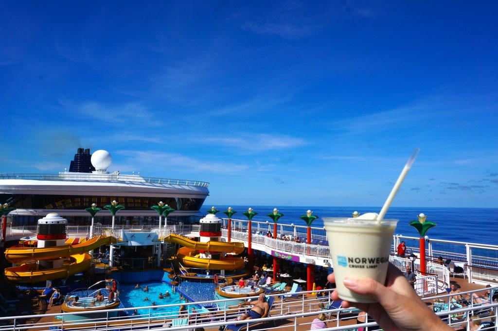 Pina colada on the pool deck of the Norwegian Star cruise ship to show how to get cheap drinks on a cruise