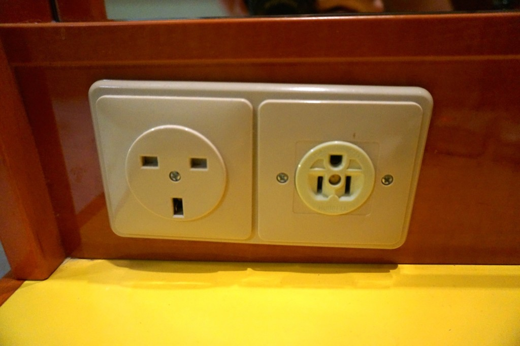 Power outlets aboard a cruise ship tend to be both European outlets and american outlets so bringing an adapter will add an usable outlet