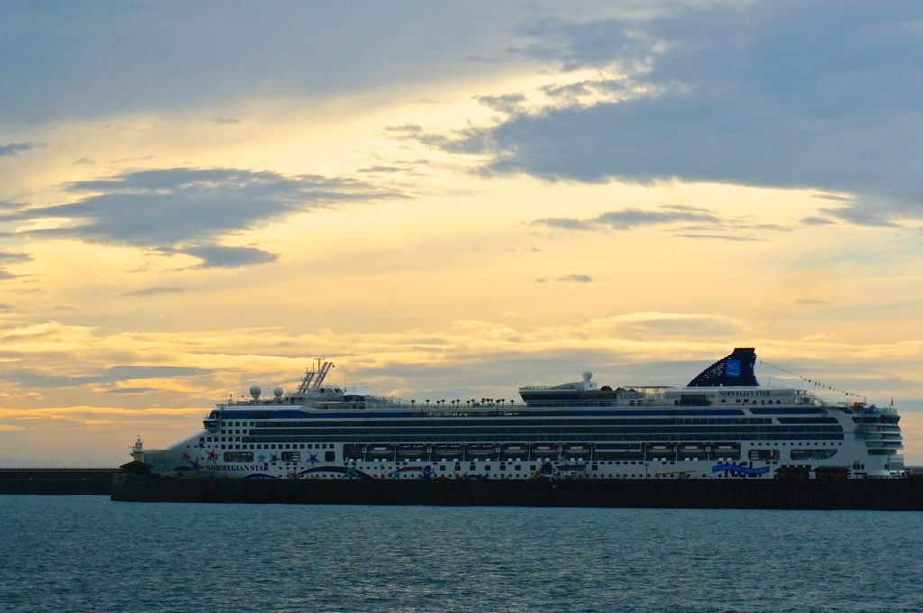 Norwegian Star glowing in the sunrise docked on Dover England