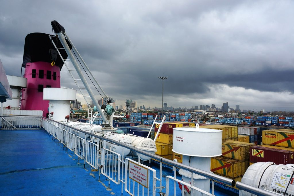 Atop the M/V Saint Pope John Paul II ferry in the a Manila, Philippines port as tropical storm clouds approach