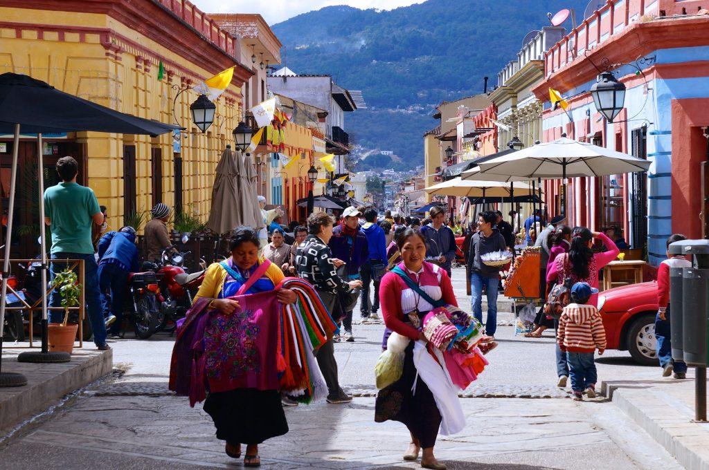 Chiapas indigenous community walks along streets of San Cristobal de las Casas Mexico