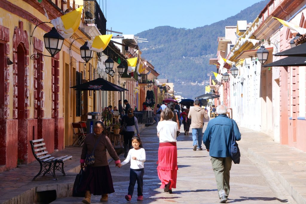 Pedestrians walk down Real de Guadalupe lined with Vatican flags in advance of the Pope's visit to San Cristobal de las Casas in Chiapas Mexico