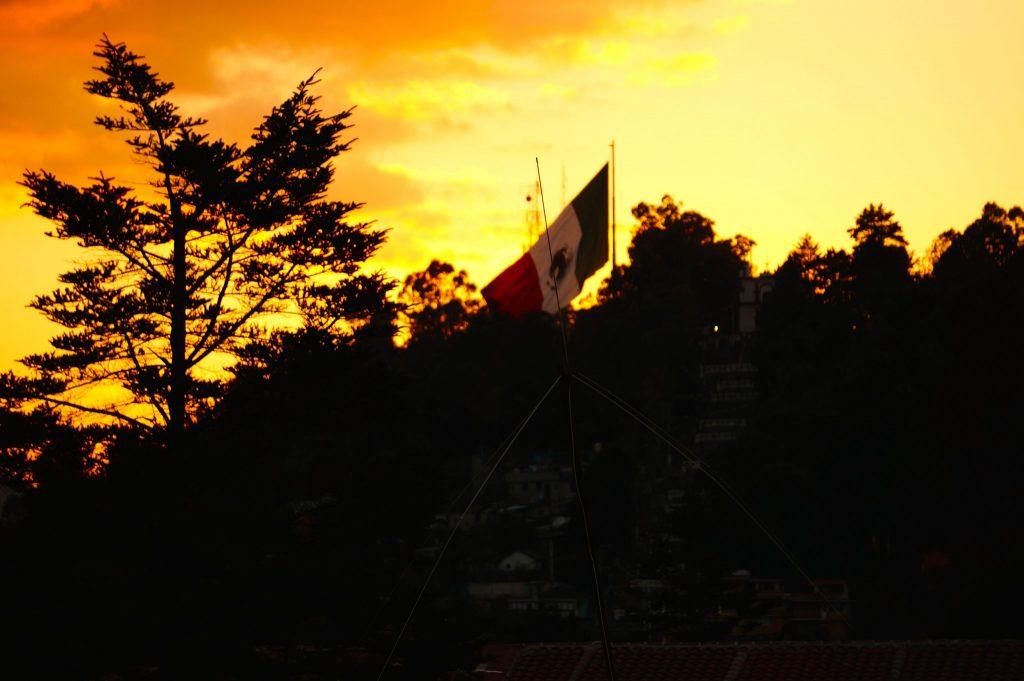 Mexican flag during sunset over San Cristobal de las Casas Chiapas Mexico