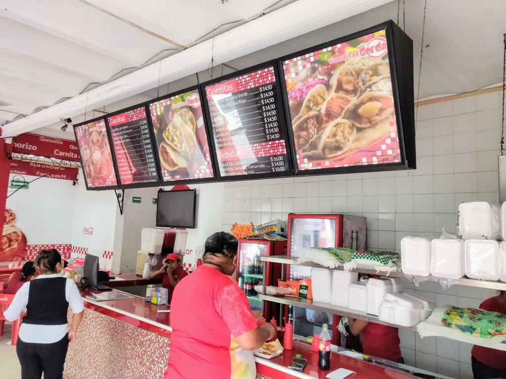 Gorditas Doña Gorda inside and menu board