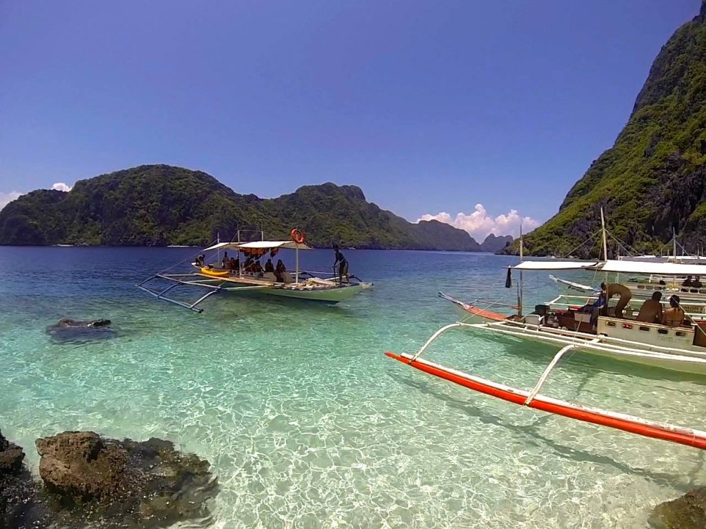 Banga boat in clear water during el nido island hopping tour