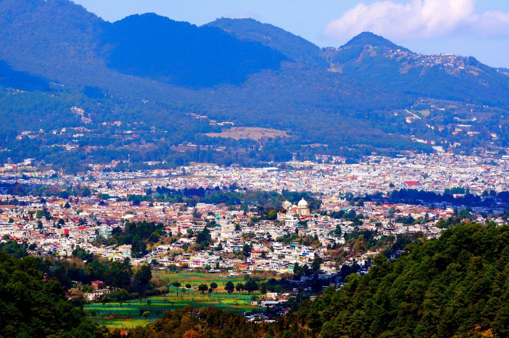 Panoramic shot of San Cristobal de las Casas Mexico as viewed from mountains above