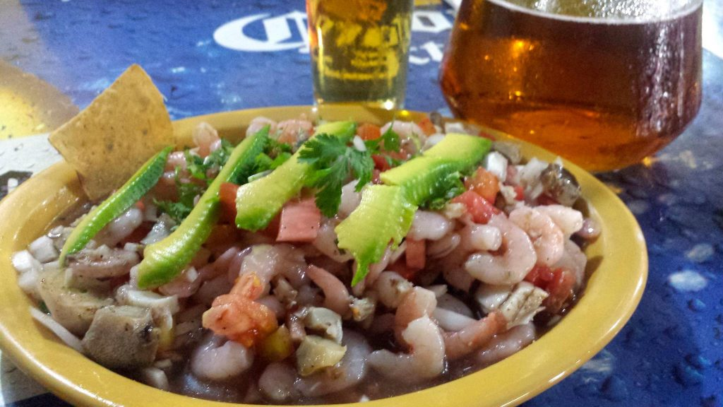 ceviche and beer at Sol y Mar restaurant in Progreso beach near Merida Mexico
