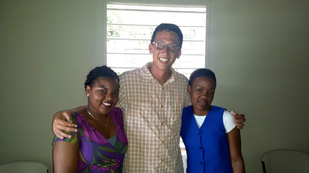 Teacher and students posing after teaching community English in Puerto Plata as part of a Fathom Travel Impact Activity